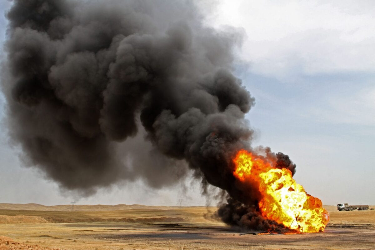 Fire and black smoke rise from an oil well in the Bay Hassan oil field, in the northern Iraqi province of Kirkuk, after being blown up by jihadists, on May 5, 2021 [SHWAN NAWZAD/AFP via Getty Images]