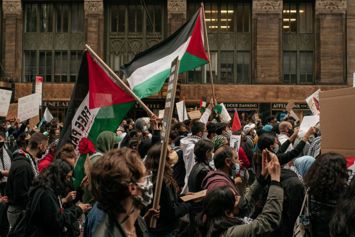 Protesters demanding an end to Israeli aggression against Palestine march in the street in Midtown Manhattan on May 11, 2021 in New York City [Scott Heins/Getty Images]