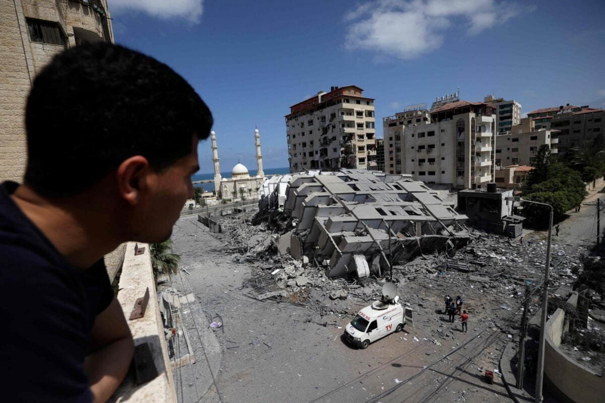 A Palestinian man looks at a destroyed building in Gaza City, following a series of Israeli airstrikes on the Hamas-controlled Gaza Strip early on May 12, 2021 [MOHAMMED ABED/AFP via Getty Images]