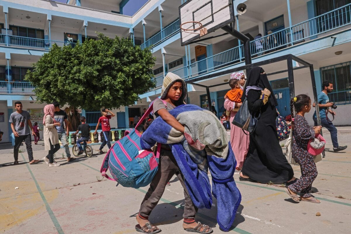 Displaced Palestinans walk in the courtyard as families took shelter at a United Nations (UN) school in Rafah in the southern Gaza Strip on May 17, 2021 [SAID KHATIB/AFP via Getty Images]