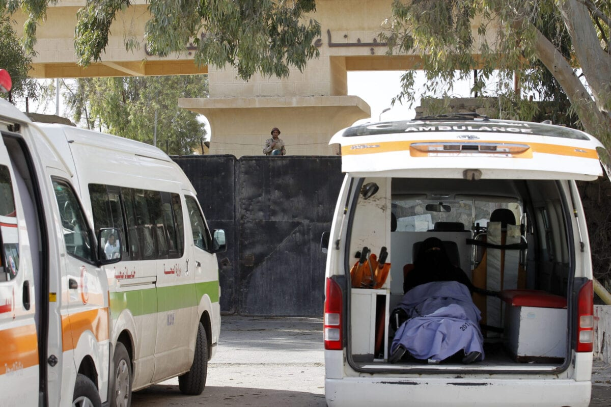 An ambulance is parked at the gate of the Rafah border crossing point [SAID KHATIB/AFP via Getty Images]