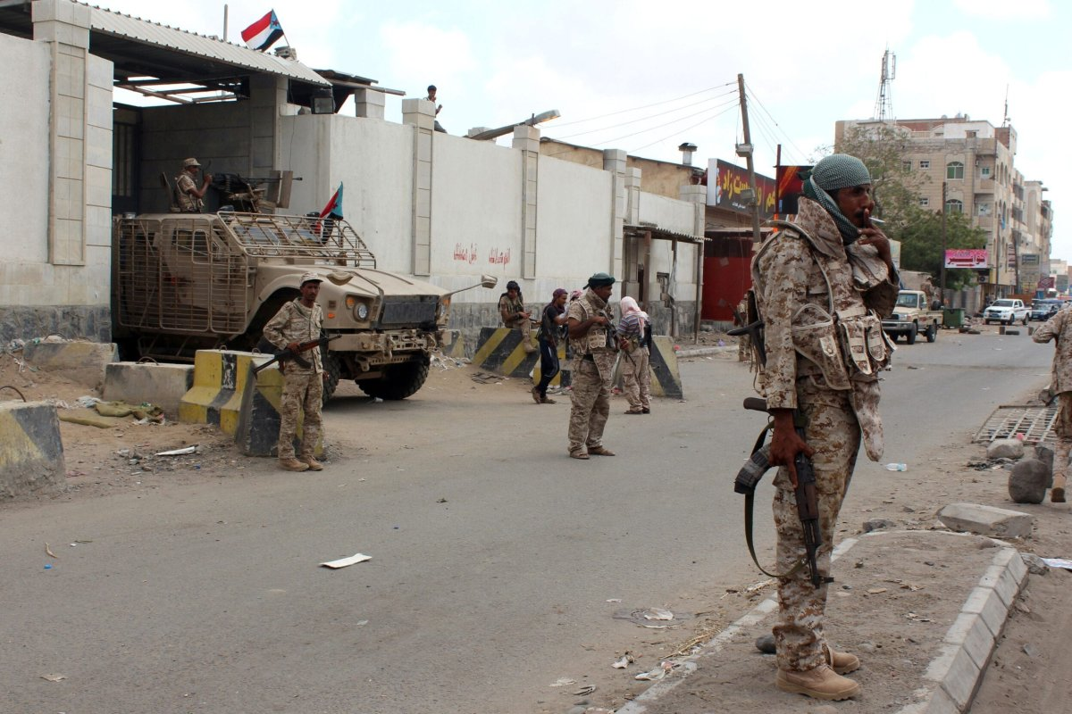 Loyalist forces stand guard outside the central prison in the Mansoura residential district of Yemen's second city of Aden on March 30, 2016 [SALEH AL-OBEIDI/AFP via Getty Images]