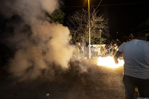 JERUSALEM - MAY 05: Israeli forces intervene in Palestinians with stun grenade during a demonstration at Sheikh Jarrah neighborhood after Israeli government's plan to force some Palestinian families out of their homes in East Jerusalem on May 05, 2021. ( Mostafa Alkharouf - Anadolu Agency )