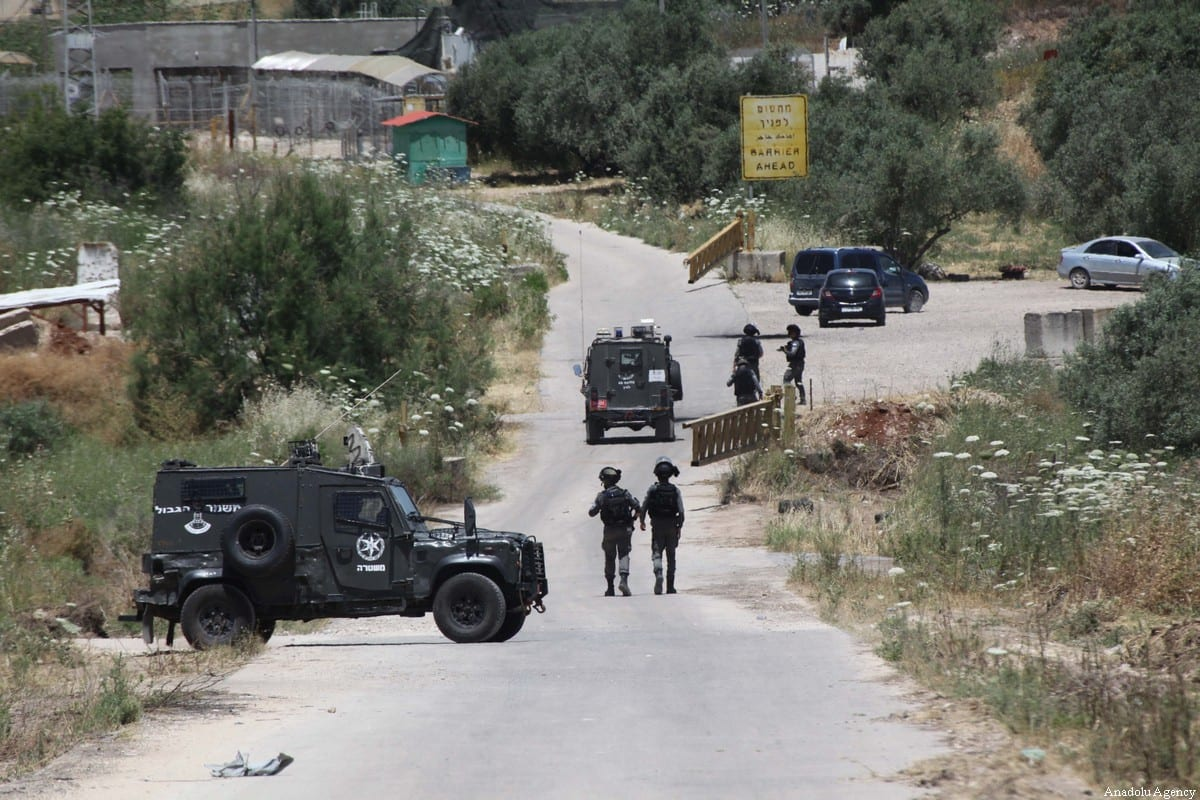 Israeli forces seen outside the Salem settlement outpost, after they killed two Palestinians and seriously injured another in the northern part of West Bank, on May 7, 2021. [Nedal Eshtayah / Anadolu Agency]