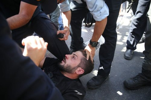 JERUSALEM - MAY 26: Israeli police take a Palestinian into custody during a protest against the Israeli court to evacuate the homes of Palestinian families in the town of Silvan ahead of the pre-trial action at the Israeli Central Court upon the objection of the Palestinians in East Jerusalem on May 26, 2021. ( Mostafa Alkharouf - Anadolu Agency )