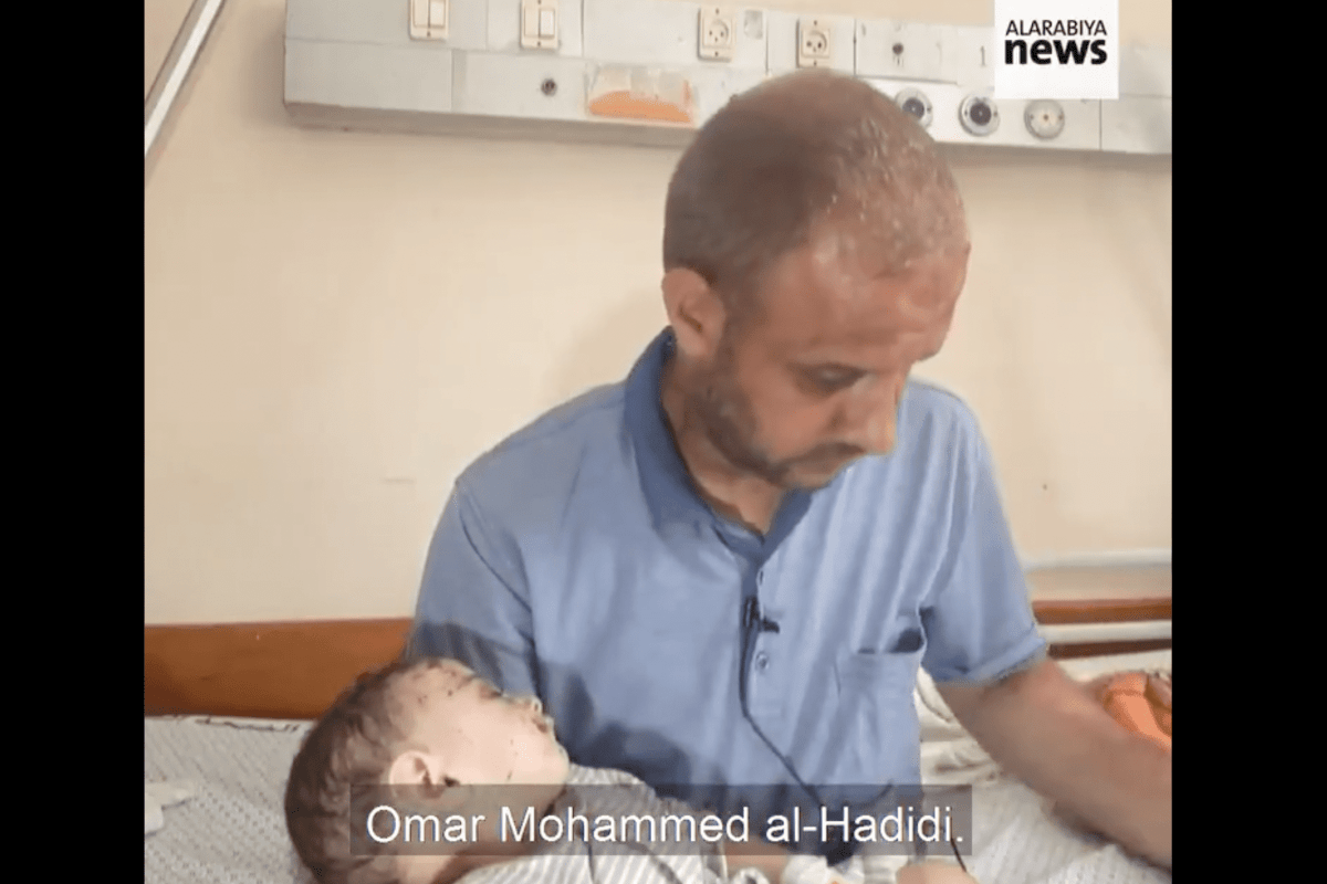 """Palestinian father Mohammad Al-Hadidi, who lost all of his family in an Israeli strike on his house in Gaza, hugging his baby in ICU, saying: """"No one remained with me except you."""""""