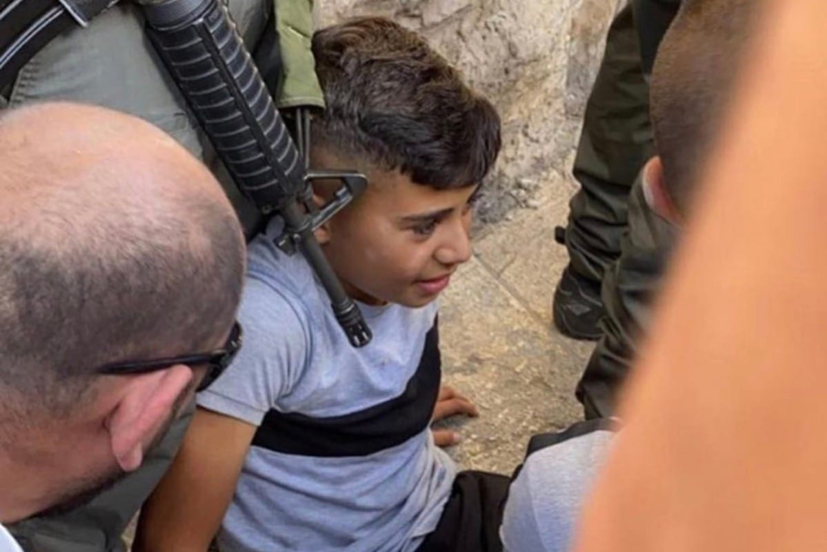 12-year-old Palestinian child was run over by Israeli police in East Jerusalem's Silwan neighborhood for placing the Palestinian flag on his bicycle [KamelHawwash/Twitter]