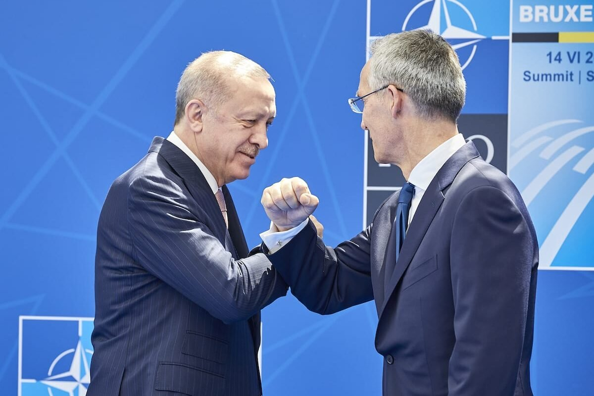 Turkish President Recep Tayyip Erdogan (L) greets NATO Secretary General Jens Stoltenberg at the NATO summit at the North Atlantic Treaty Organization (NATO) headquarters in Brussels, on 14 June 2021. [NATO/Pool - Anadolu Agency]
