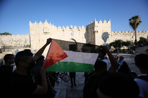 Palestinians stage a demonstration at Damascus Gate in Old City to protest against Jewish settlers' blasphemy of Prophet Muhammad, on 19 June 2021 in Jerusalem. [Mostafa Alkharouf - Anadolu Agency]