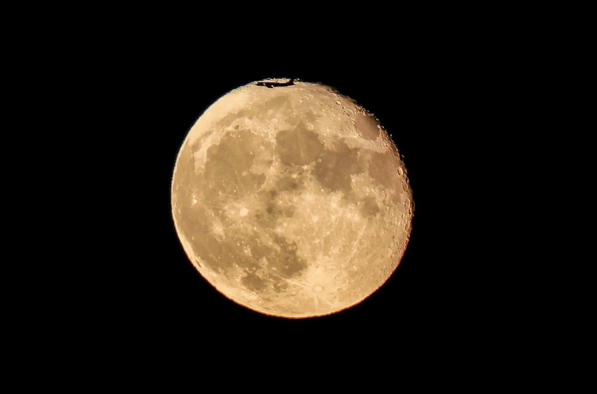 Full moon rises over the sky at the evening hours in Ankara, Turkey on June 26, 2021 [Halil Sağırkaya/Anadolu Agency]