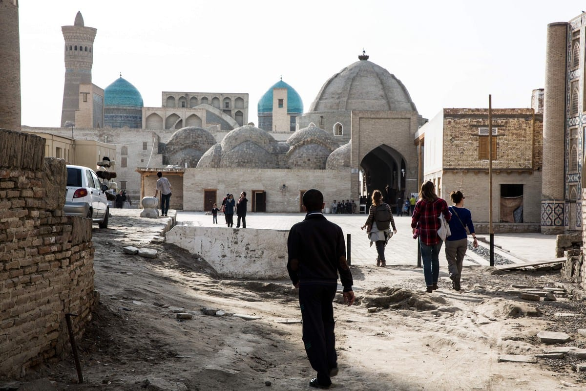 Pedestrians walk towards the old city in Bukhara, Uzbekistan, 8 March 2018 [Taylor Weidman/Bloomberg/Getty Images]