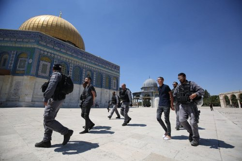 """Israeli forces take Palestinians into custody during a demonstration near Qubbat al-Sakhra (the Dome of the Rock) against far-right Israelis' slogans insulting Prophet Muhammad during """"flag march"""" in Jerusalem on June 18, 2021. [Mostafa Alkharouf - Anadolu Agency]"""