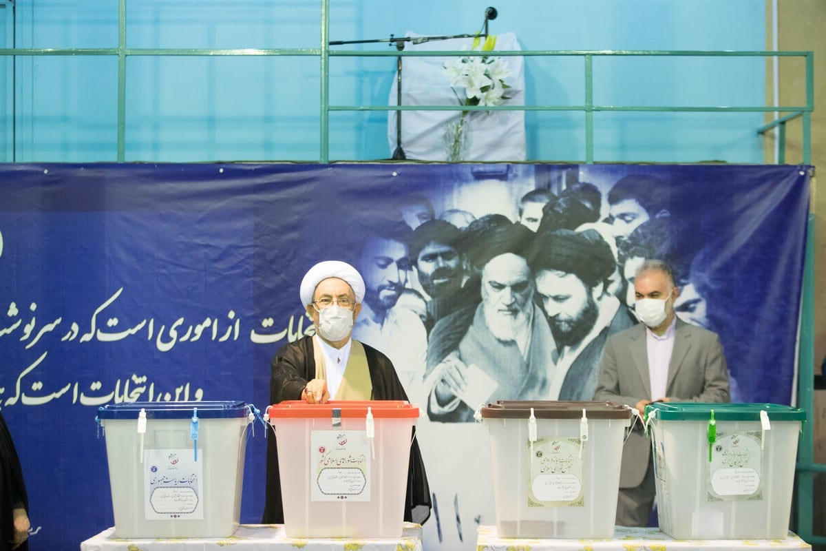 Ali Younesi casts his ballot for presidential election in Tehran, Iran on 18 June 2021 [Mohammad Reza Abbasi ATPImages/Getty Images]