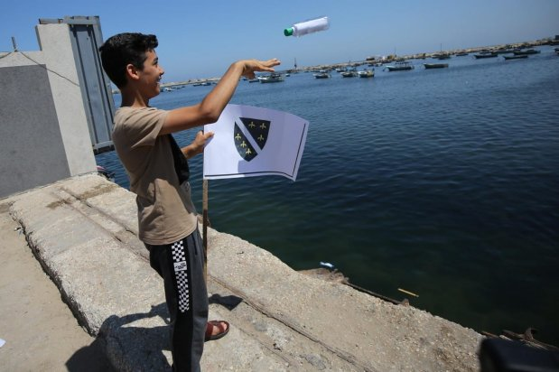 Children at the port of Gaza put their letters of dreams and aspirations into bottles and threw them into the sea in the hope that they would reach the world, 30 June 2021 [Mohammed Asad/Middle East Monitor]