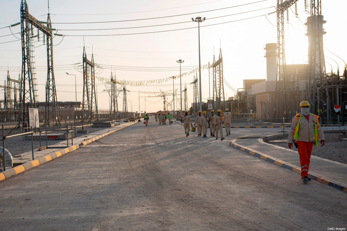 Employees walk the ground of the Dhi Qar Combined Cycle Power Plant near the Iraqi city of Nasiriyah on June 15, 2020. (Photo by Hussein FALEH / AFP) (Photo by HUSSEIN FALEH/AFP via Getty Images)