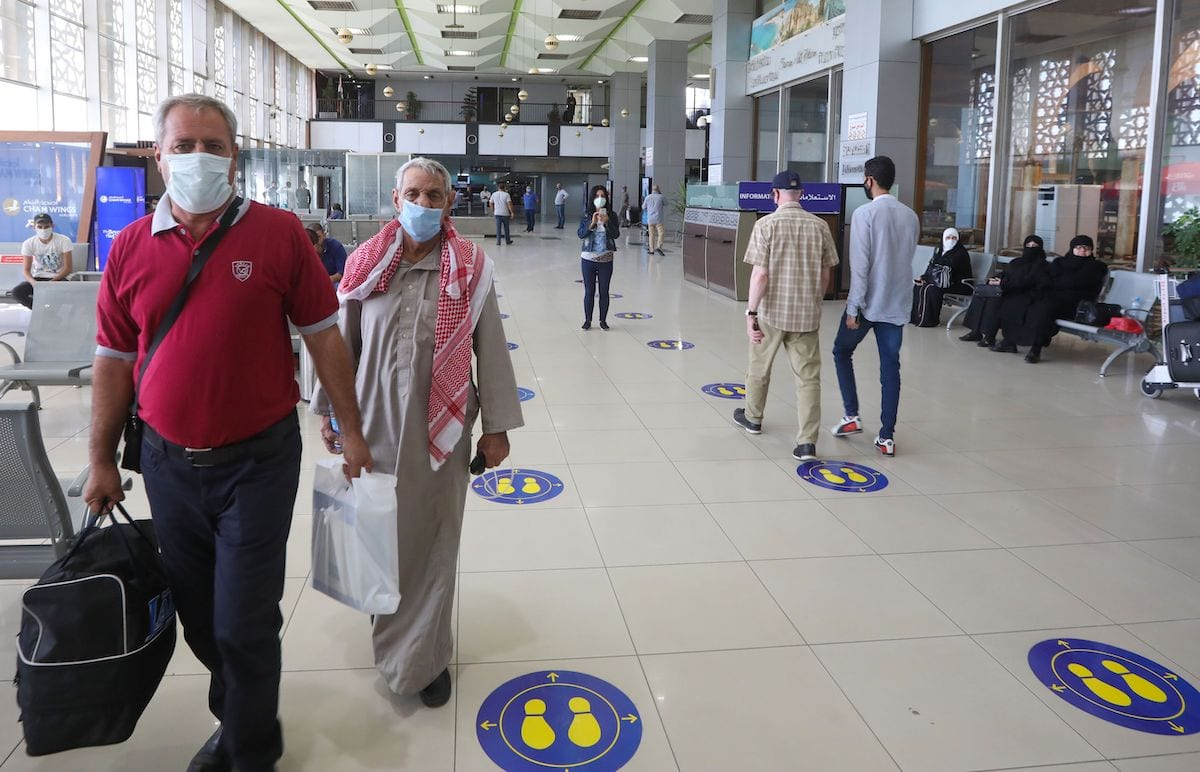 Passengers at the Damascus International airport in the Syrian capital on October 1, 2020. [LOUAI BESHARA/AFP via Getty Images]