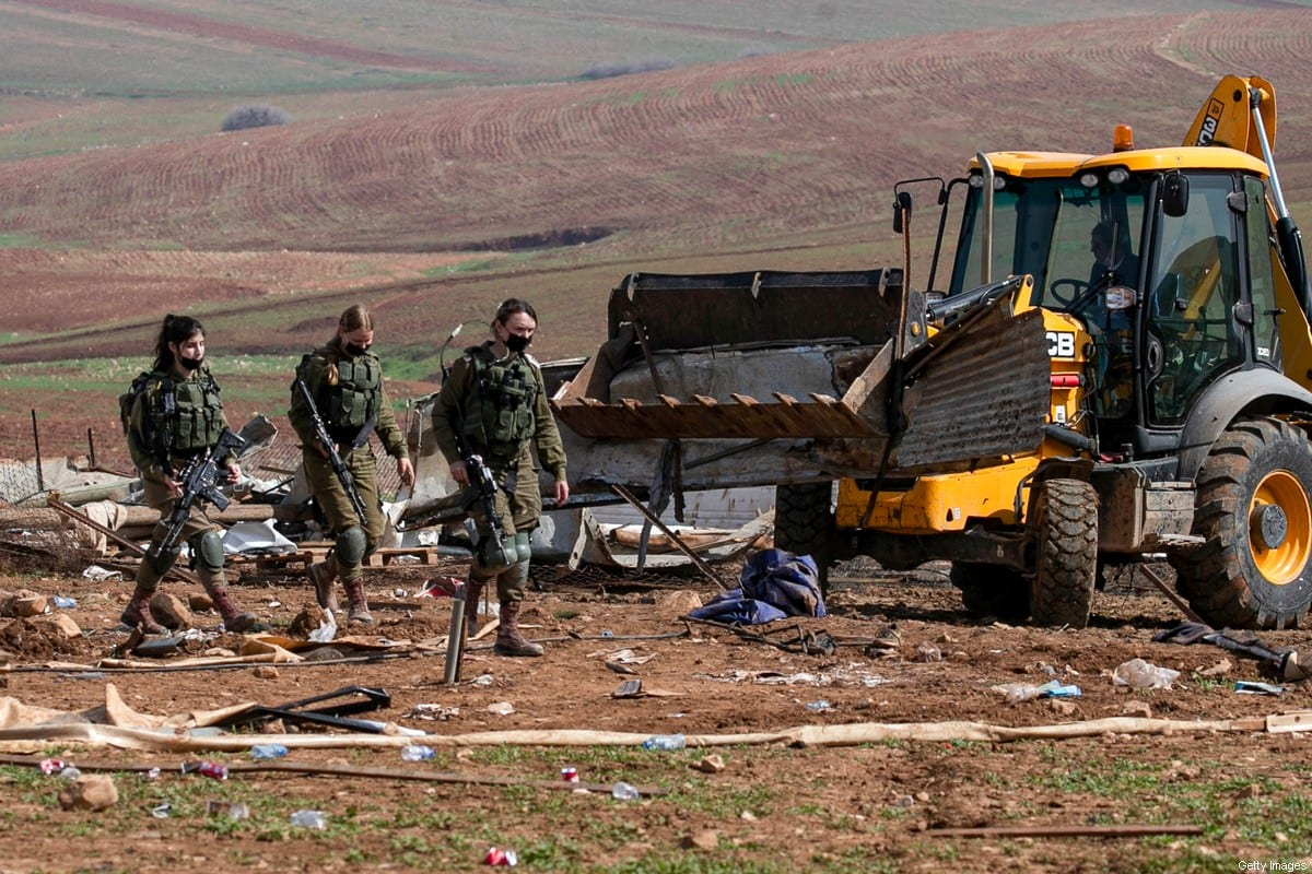 Israeli forces demolish Bedouin tents and structures in the Humsa area east of the Palestinian village of Tubas, in the occupied West Bank, on 8 February 2021 [JAAFAR ASHTIYEH/AFP/Getty Images]