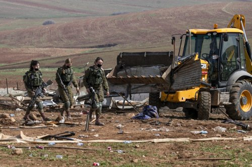 Israeli forces demolish Bedouin tents and structures in the Humsa area east of the Palestinian village of Tubas, in the occupied West Bank, on February 8, 2021 [JAAFAR ASHTIYEH/AFP via Getty Images]