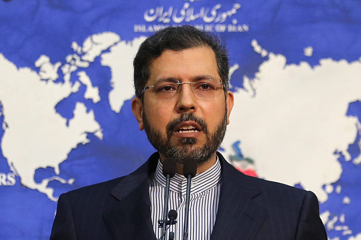 """Iranian foreign ministry spokesman Saied Khatibzadeh gestures during a press conference in Tehran on February 22, 2021. - Iran hailed as a """"significant achievement"""" a temporary agreement Tehran reached with the head of the UN nuclear watchdog on site inspections. That deal effectively bought time as the United States, European powers and Tehran try to salvage the 2015 nuclear agreement that has been on the brink of collapse since Donald Trump withdrew from it. (Photo by ATTA KENARE / AFP) (Photo by ATTA KENARE/AFP via Getty Images)"""