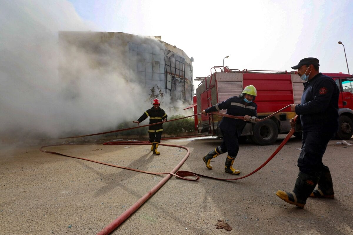 Firefighters in Cairo, Egypt, on March 11, 2021 [KHALED KAMEL/AFP via Getty Images]