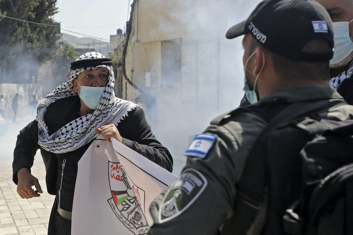 Israeli security members clash with Palestinian demonstrators commemorating land day and protesting settler visits to archaeological and historical sites in the Palestinian village of Sebastia, northwest of Nablus in the occupied West Bank, on 30 March 2021. [JAAFAR ASHTIYEH/AFP via Getty Images]