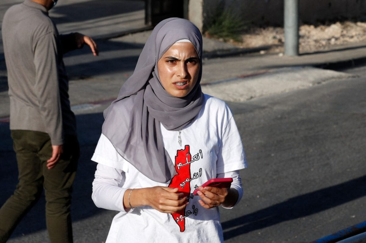 Palestinian activist Muna al-Kurd takes part in a rally to demand the reopening of the Israeli Police checkpoint at the entrance of the Sheikh Jarrah neighbourhood in east Jerusalem, on May 29, 2021 [AHMAD GHARABLI/AFP via Getty Images]