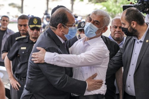 Yahya Sinwar (L), Hamas' political chief in Gaza, embraces General Abbas Kamel (R), Egypt's intelligence chief, as the latter arrives for a meeting with leaders of Hamas in Gaza City on May 31, 2021 [MAHMUD HAMS/AFP via Getty Images]