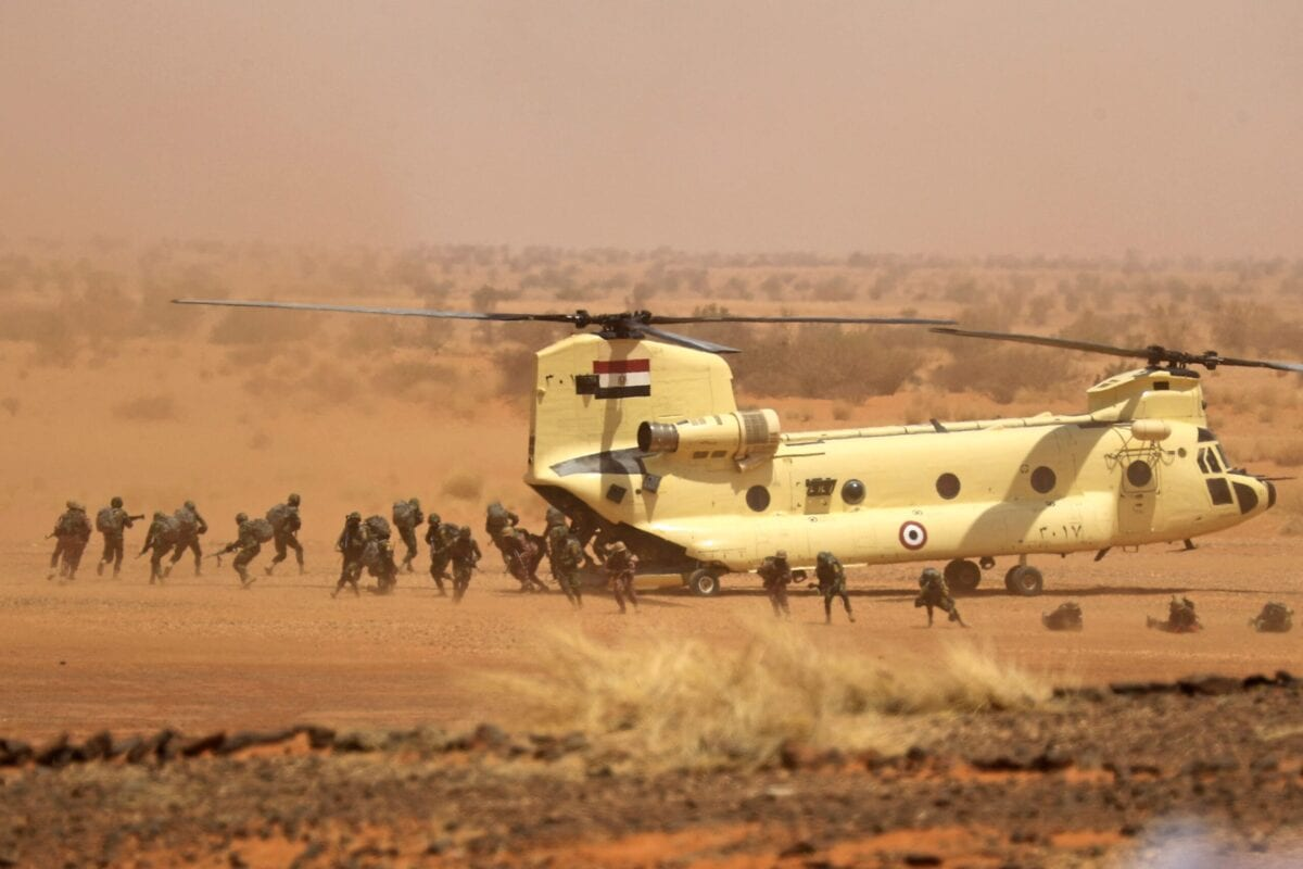 """Soldiers disembark off an Egyptian Air Force CH-47 Chinook helicopter during the """"Guardians of the Nile"""" joint military drill between Egypt and Sudan in the Um Sayyala area, northwest of Khartoum, on May 31, 2021. (Photo by ASHRAF SHAZLY / AFP) (Photo by ASHRAF SHAZLY/AFP via Getty Images)"""
