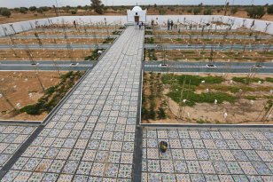 """""""Jardin d'Afrique"""", or Garden of Africa, a cemetery in southern Tunisia for migrants who drowned crossing the Mediterranean in the hope of a better life in Europe, on June 1, 2021 in the port town of Zarzis, near the Libyan border [FATHI NASRI/AFP via Getty Images]"""