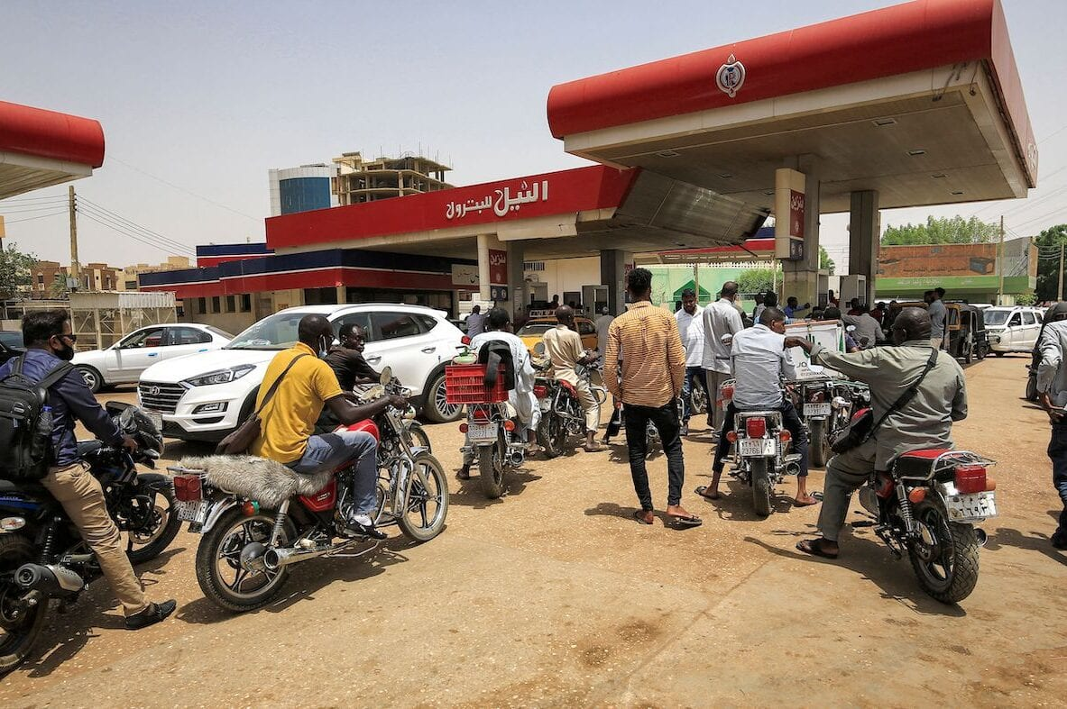 Motorcyclists queue-up for fuel at a petrol station in al-Amarat district of Sudan's capital Khartoum on 10 June 2021. [ASHRAF SHAZLY/AFP via Getty Images]