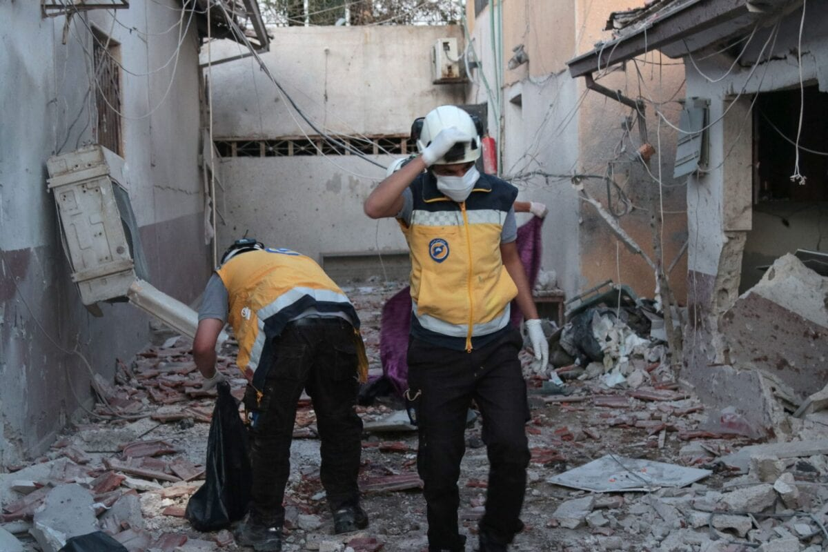 Members of Syria's Civil Defence service (White Helmets) sift through the rubble at Al-Shifaa hospital following shelling of the rebel-held city of Afrin in northern Syria, on June 12, 2021 [BAKR ALKASEM/AFP via Getty Images]