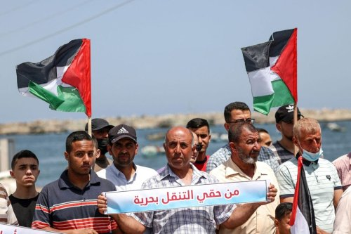 Palestinian fishermen protest at Gaza seaport against the reduction by Israel of the fishing area to six nautical miles, in Gaza City, on June 13, 2021. The banner reads in Arabic:'I have the right to sail' [MAHMUD HAMS/AFP via Getty Images]