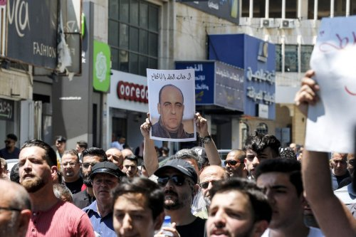 Palestinians gather for a demonstration in protest against the death of activist Nizar Banat, who died during his arrest by Palestinian security forces, in the city of Hebron in the occupied West Bank on 24 June 2021. [MOSAB SHAWER/AFP via Getty Images]