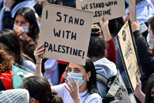 Protestors have gathered in solidarity with the people of Palestine amid the Israeli war on Gaza on May 16, 2021 in Glasgow, Scotland. [Jeff J Mitchell/Getty Images]