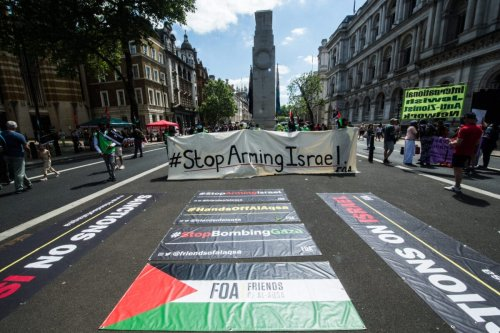 Protest banners are laid on the road near Downing Street on June 12, 2021 in London, England [Guy Smallman/Getty Images]