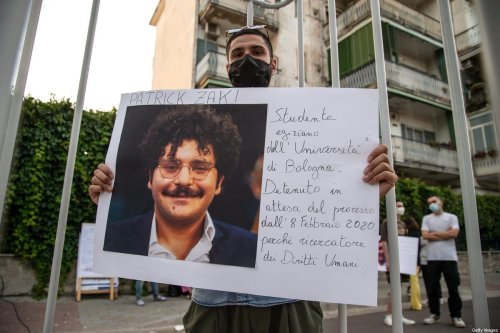 A man shows a photograph of Patrick Zaki during a demonstration in solidarity with Patrick Zaki and human rights activists detained around the world on 16 June 2021 in Naples, Italy. [Ivan Romano/Getty Images]