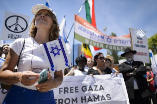 Supporters of Israel stage a protest on June 29, 2015 in front of the United Nations Office in Geneva, during a session of the Human Right Council on the report of the Commission of Inquiry on the 2014 Gaza war. [FABRICE COFFRINI/AFP via Getty Images]