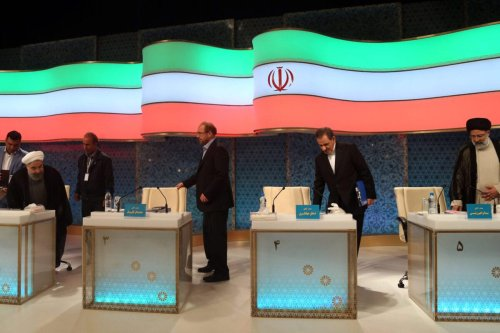 Iranian presidential candidates (L to R) Hassan Rouhani, Mohammad Baqer Ghalibaf, Eshaq Jahangiri and Ebrahim Raisi attend a live debate on state TV in Tehran on April 28, 2017 [JAMEJAMONLINE/AFP via Getty Images]