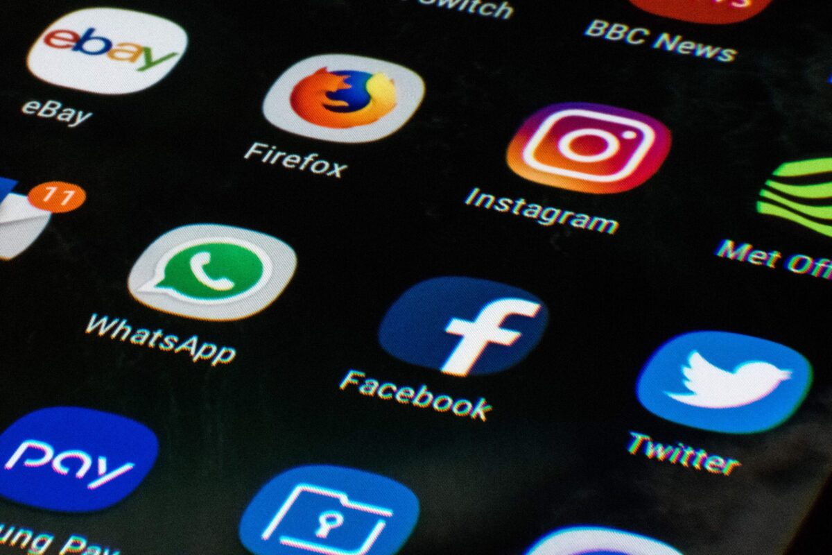 A mobile phone screen displays the icons for the social networking apps Facebook, Twitter and Instagram, taken in Manchester, England on March 22, 2018 [OLI SCARFF/AFP via Getty Images]