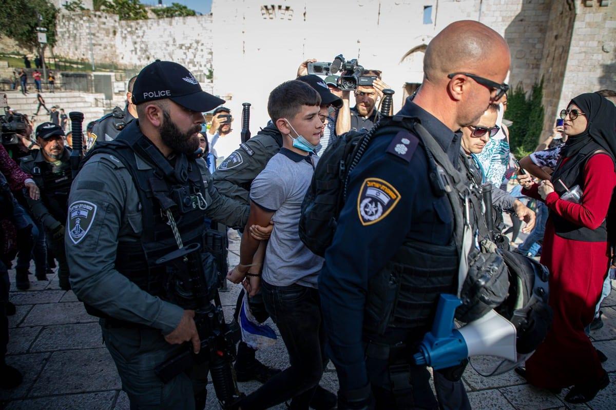 Israeli forces take a Palestinian minor into custody in Jerusalem on 10 June 2021 [Eyad Tawil/Anadolu Agency]