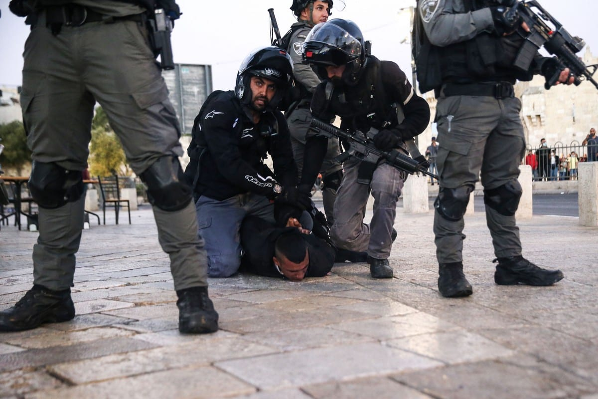 """A Palestinian youth is detained by Israeli forces as a group of Palestinian gather to protest against far-right Israelis' slogans insulting Prophet Muhammad during yesterday's """"flag march"""" at Damascus Gate in Old City of Jerusalem on June 17, 2021 [Mostafa Alkharouf / Anadolu Agency]"""