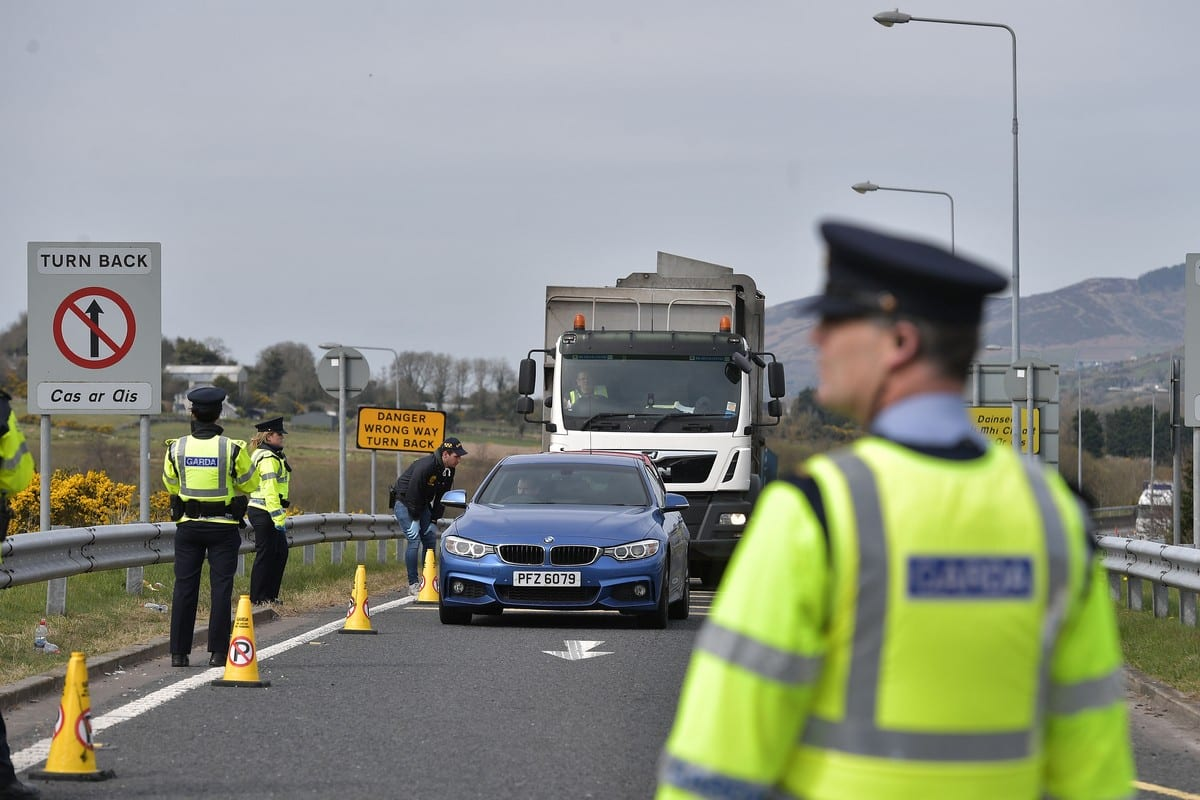 Gardai police officers man a checkpoint on the border in Northern Ireland on 9 April 2020 [Charles McQuillan/Getty Images]