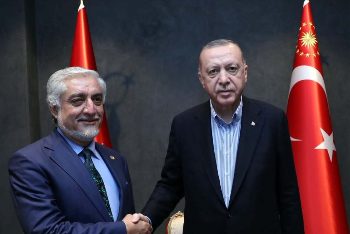 Turkish President Recep Tayyip Erdogan (R) meets the Minister of Foreign Affairs with the Chairman of the Supreme Council for National Reconciliation of Afghanistan Abdullah Abdullah (L) in Antalya, Turkey on June 18, 2021.[TUR Presidency/Murat Cetinmuhurdar/Anadolu Agency]