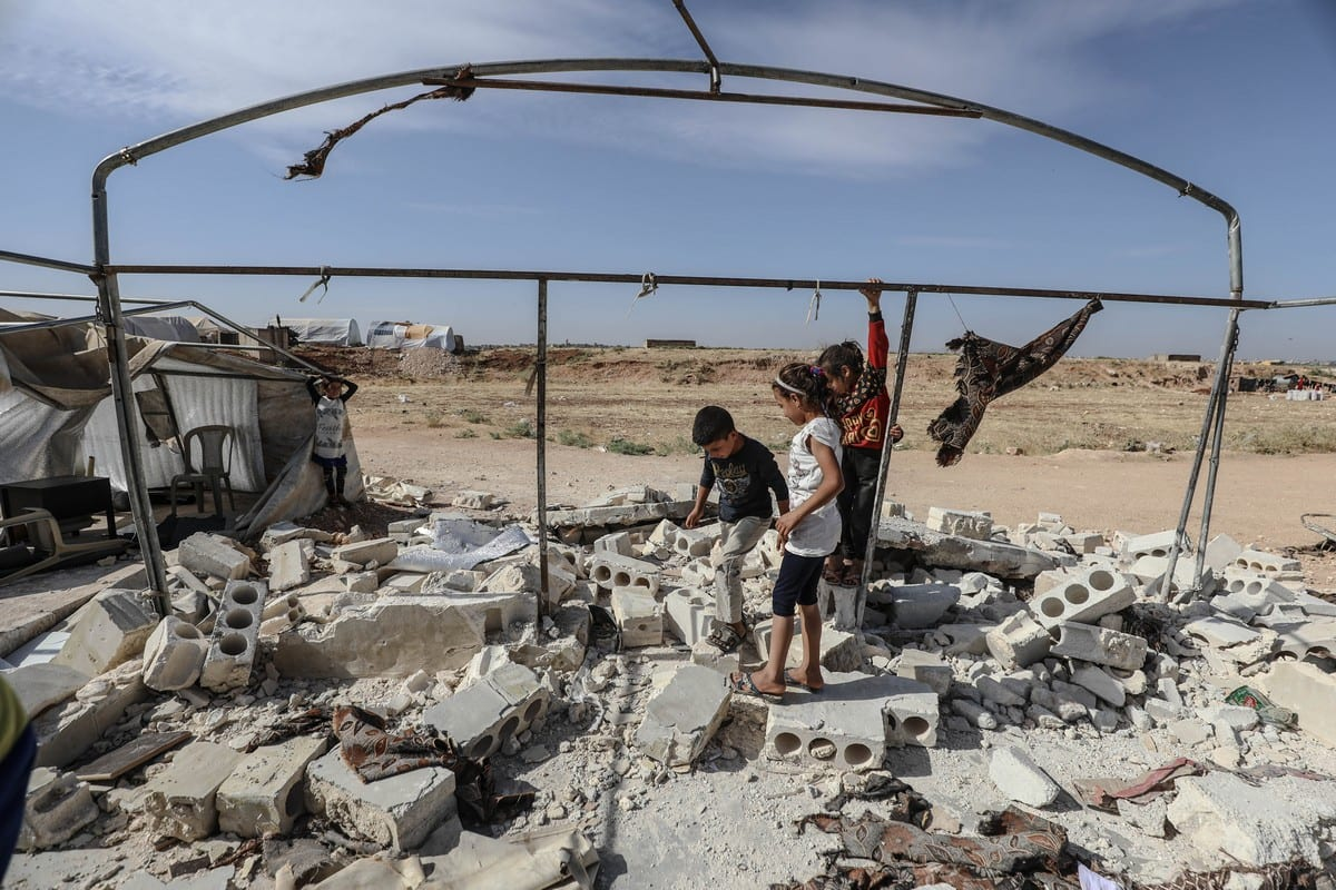 Syrian children are seen among the rubble of a collapsed school after it was hit by Assad Regime in Idlib, Syria on 11 June 2021 [Izzeddin Kasim/Anadolu Agency]