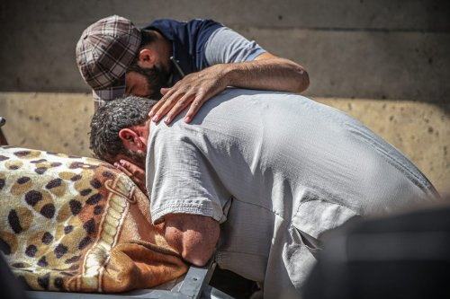 Relatives mourn during a funeral held for Syrian children who were killed by Bashar Al-Assad in Idlib, Syria on 3 July 2021 [Muhammed Said/Anadolu Agency]