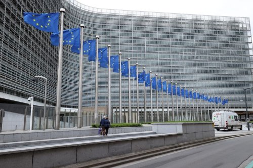 BRUSSELS, BELGIUM - JULY 6 : European Union flags are seen waving outside the EU Commission Building in Brussels, Belgium on July 6, 2021. ( Dursun Aydemir - Anadolu Agency )