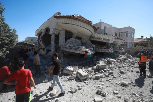 Palestinians inspect the debris of a building after Israeli forces demolished two-storey house of 44 year old Palestinian prisoner Muntasir Shelbi, where his family lived, in Turmusaya town of Ramallah, West Bank on 8 July 2021. [İssam Rimawi - Anadolu Agency]