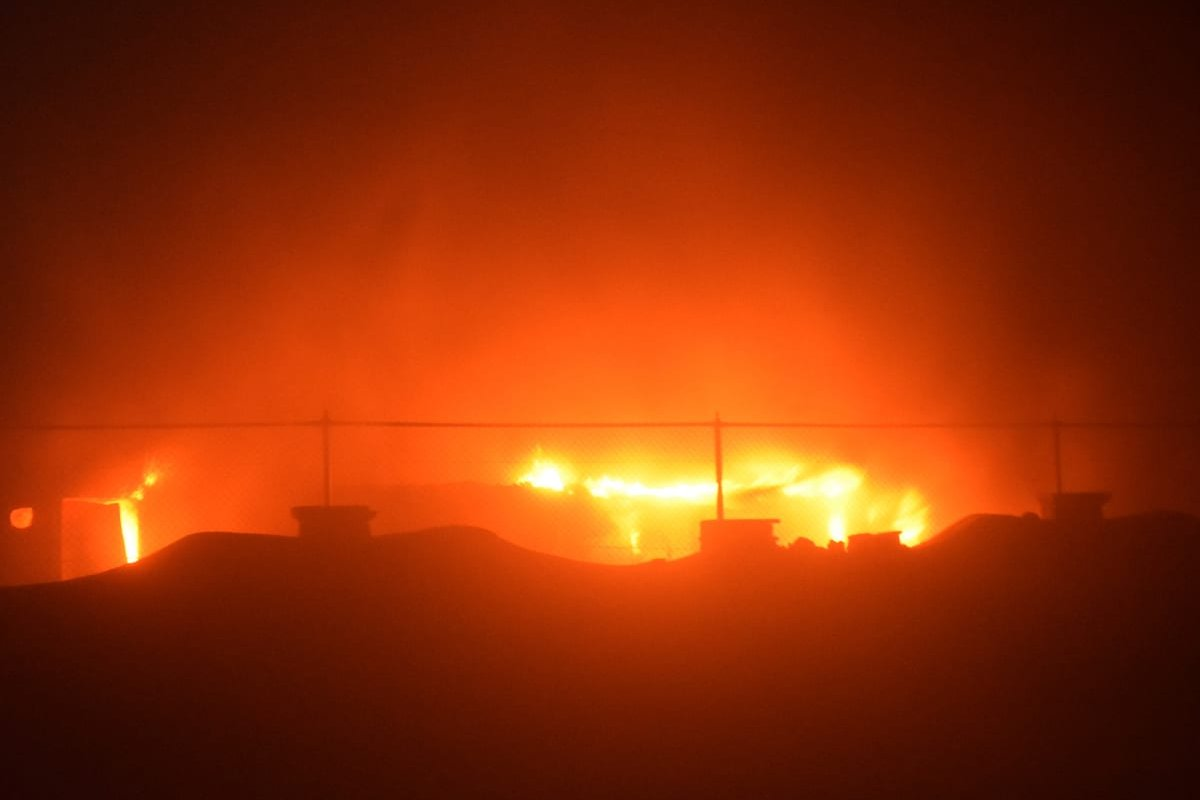 DHI QAR, IRAQ - JULY 13: Smoke rises after fire broke out for an unknown reason in a COVID-19 isolation ward of Al-Hussein Hospital in Nasiriya city in Dhi Qar governorate, Iraq on July 13, 2021. At least 36 people have been killed and five others injured. ( Arshad Mohammed - Anadolu Agency )