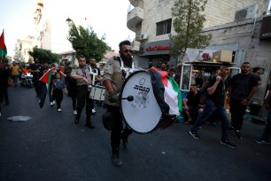 Palestinian scouts parade ahead of the Eid al-Adha in Ramallah, West Bank on July 19, 2021 [Issam Rimawi/Anadolu Agency]