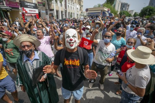 Tunisians stage a protest in response to the problems in the health sector in the country, demanding the resignation of the government and the dissolution of the parliament in Tunis, Tunisia on 25 July 2021. [Yassine Gaidi - Anadolu Agency]